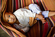 Baby in hammock. Mandalay, Myanmar