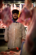 A butcher in the Athinas street meat markets. Known as Athens Agora (Athens Market) it has been the city's primary market since 1886. Image © Angelos Giotopoulos/Falcon Photo Agency