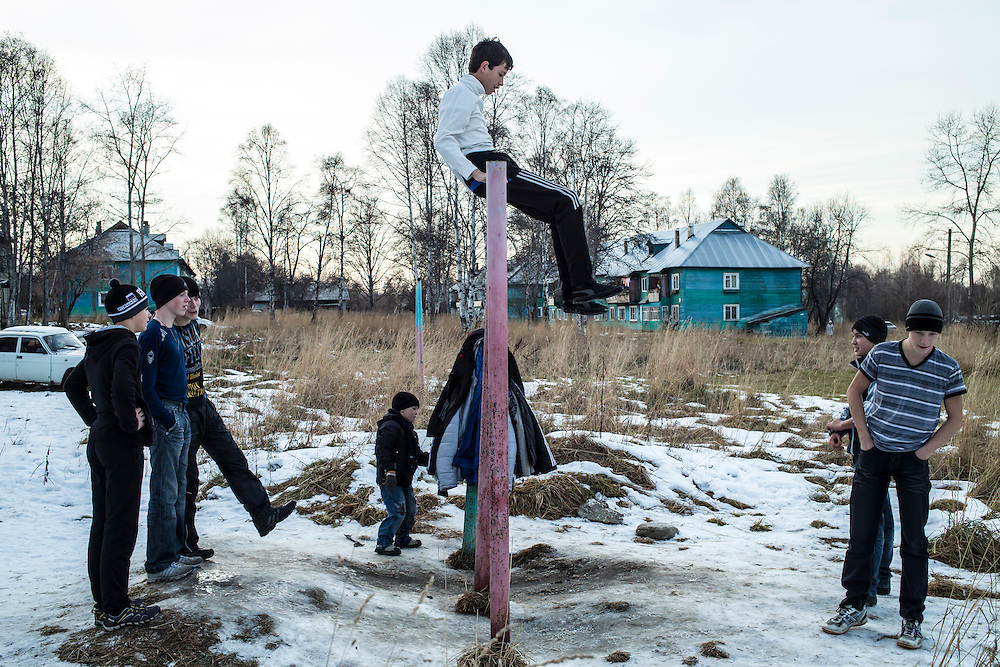 Boys play outside after school on Thursday, October 24, 2013 in Baikalsk, Russia.