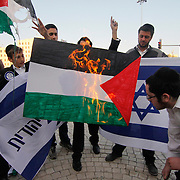 Right-wing Jewish activists burn a Palestinian flag near the Harp bridge in Jerusalem as Palestinians clash with Israeli troops all over East Jerusalem and the West Bank on the 63rd anniversary of Nakba (catastrophe in Arabic), the term Arabs use to describe the uprooting of thousands of Palestinians with the 1948 creation of the state of Israel. May 15, 2011.  Photo by Oren Nahshon.