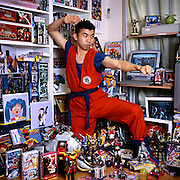 Nakayasu, 33, is a professional collector. He buys items for his collection and sells them like a business, but also works a part time job in a call center. He collects toys from Japanese anime and live action special effects (tokusatsu) TV shows, soundtrack CDs, printed materials and videogames. At the time of this photograph, he had been collecting for eight years, and massed a collection worth about US$20,000. He has 200 toys alone.