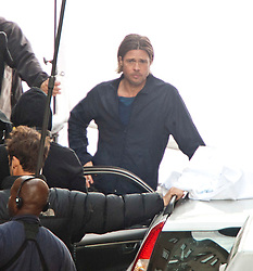 """Day 2. Brad Pitt on the set of the movie """"World War Z"""" being shot in the city centre of Glasgow. The film, which is set in Philadelphia, is being shot in various parts of Glasgow, transforming it to shoot the post apocalyptic zombie film..© pic : Michael Schofield."""
