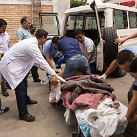 Ambulance and hospital staff from Occidente Hospital work at trying to save a bus accident victim at Occidente Hospital in Santa Rosa de Copan, Honduras, October 31, 2014. Central America Medical Outreach (CAMO), a humanitarian organization supports the hospital providing life-saving medical services, education, and many other services to the community.