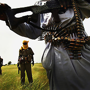 MISTEREI, SUDAN- SEPTEMBER 07:  Heavily armed rebel Sudanese Justice and Equality Movement (JEM) fighters patrol looking for Janjaweed militiamen near their base in the Darfur region of Sudan 07 September, 2004 . Both rebel groups, the JEM, and the Sudanese Liberation Movement (SLM) continue to abide by a current ceasefire and are participating in talks with the Sudanese government in neighboring Nigeria, but are growing increasingly frustrated by the lack of progress and warn of an impending resumption of military action if the situation in Darfur does not improve dramatically within the next weeks. (Photo by Scott Nelson/Getty Images)