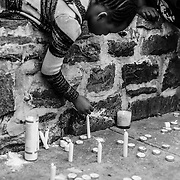 WASHINGTON, USA - APRIL 21: A young girl lights candles in a memorial for Freddie Gray who died from injuries suffered in Police custody in Baltimore, USA on April 21, 2015.