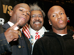 IBF Welterweight Champion Zab Judah (r) and Floyd Mayweather (l) pose with promoter Don King at the press conference announcing their upcoming fight.  The fight will take place on April 8, 2006 in Las Vegas.