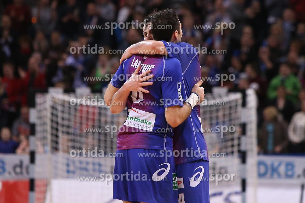 HANDBALL:  Germany 1. Bundesliga, Hamburg, 13.02.2014<br />Domagoj Duvnjak and Blazenko Lackovic (HSV HandBall) <br />celebration<br /> copyright: pixathlon