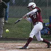 Caravel Academy Infielder Katrina Conner (11) makes contact with the ball during a varsity scheduled game between Caravel Academy and The Delmar Wildcats Saturday, April 4, 2015, at Caravel Athletic Field in Bear Delaware.