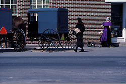two amish women outside local farmers market