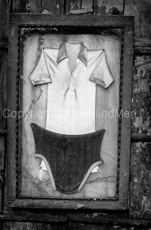 Framed shirt and underwear advertising a laundry.