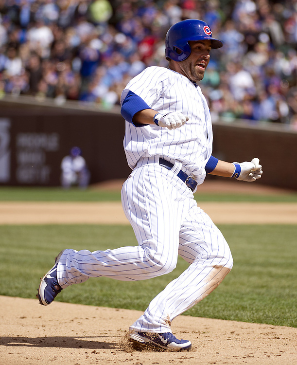 CHICAGO - MAY  04:  David DeJesus #9 of the Chicago Cubs slides safely into third base while hitting a triple against the Los Angeles Dodgers on May 4, 2012 at Wrigley Field in Chicago, Illinois.  The Cubs defeated the Dodgers 5-4.  (Photo by Ron Vesely)   Subject:  David DeJesus