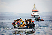 Refugees approach a northern shore of Lesvos island in Greece on Aug 15th, 2015. There are sometimes more than sixty people on inflatable boats which is usually for around twenty people and each person pays at least $1,200 for it.