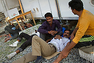 Pakistani migrants sleep and relax on a one hour break from their detention cell in the border police station of Tychero, Evros, Greece.