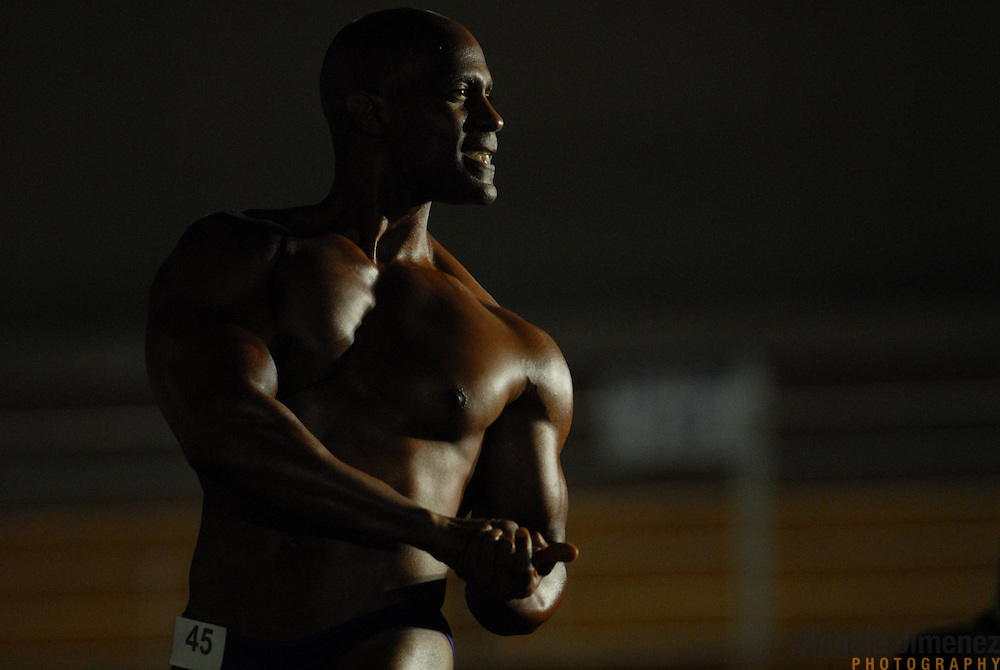 David Moore, of Chicago, Illinois, poses during the Physique (bodybuilding) competition 40-49 year old age group heavyweight division at McGaw Memorial Hall/Welsh-Ryan Arena at Northwestern University in Evanston, Illinois during the Gay Games VII competition on July 19, 2006. <br />  <br /> <br /> Moore finished second in the modified category in his division. <br /> <br /> Over 12,000 gay and lesbian athletes from 60 countries are in Chicago competing in 30 sports during the Games from July 15 through 22, 2006. <br /> <br /> Over 50,000 athletes have competed in the quadrennial Games since they were founded by Dr. Tom Wadell, a 1968 Olympic decathlete, and a group of friends in San Francisco in 1982, with the goal of using athletics to promote community building and social change. <br /> <br /> The Gay Games resemble the Olympics in structure, but the spirit is one of inclusion, rather than exclusivity. There are no qualifying events or minimum or maximum requirements.<br /> <br /> The Games have been held in Vancouver (1990), New York (1994), Amsterdam (1998), and Sydney (2002).