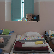 Beds and bedding in a room in Villa Artemis, a shelter for 30 refugee women and their children in the grounds of Leros Hospital. <br /> <br /> Opened in September 2015, the shelter was run by the Leros Solidarity Network. However, Villa Artemis was closed down shortly after the opening of a 'Hotspot' (EU-run migrant's reception centres) camp in Lepida in February 2016.