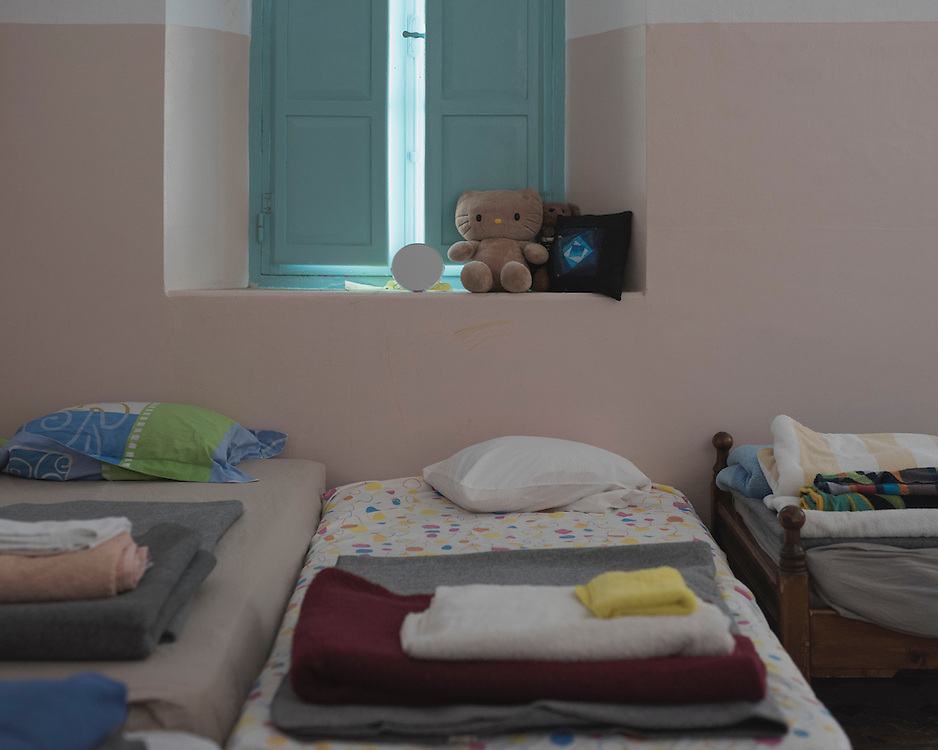 Beds and bedding in a room in Villa Artemis, a shelter for 30 refugee women and their children in the grounds of Leros Hospital. <br />