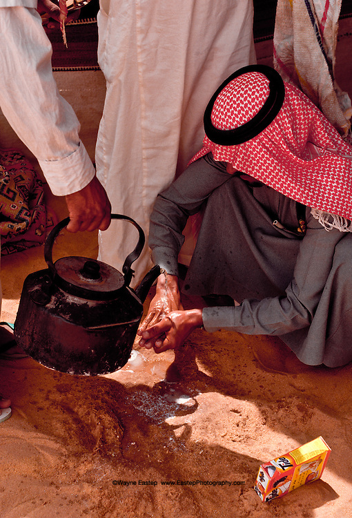 The Bedouin wash before and after eating.  They take special care to be clean and regularly put on perfume after washing.