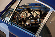 Image detail of a Porsche 911 dashboard and steering wheel