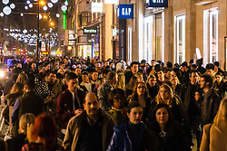 London, November 29th 2014. Tens of thousands of shoppers flood central London as  Black Friday discounts and most people's pay days kick off the Christmas shopping season in earnest. PICTURED:  Thousands of shoppers make their way along Oxford Street as darkness falls.