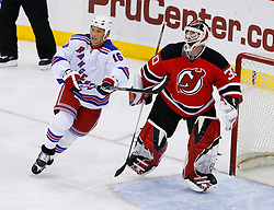 March 19, 2008; Newark, NJ, USA;  New York Rangers left wing Sean Avery (16) skates by New Jersey Devils goalie Martin Brodeur (30) during the third period at the Prudential Center. The Rangers beat the Devils 2-1 in an overtime shootout.