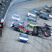 Joey Logano in the (20) car bounces off the wall and crashes into Clint Bowyer (33) on the final lap of NASCAR Nationwide Series race at Dover International Speedway in Dover Delaware.<br />