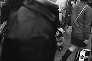 A child is seperated from it's mother in the crowds of Shibuya Station, Tokyo, Japan. March 2003.