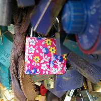 Europe, France, Paris. Pink Love-lock on the Pont de l'Archevêché over the Seine.