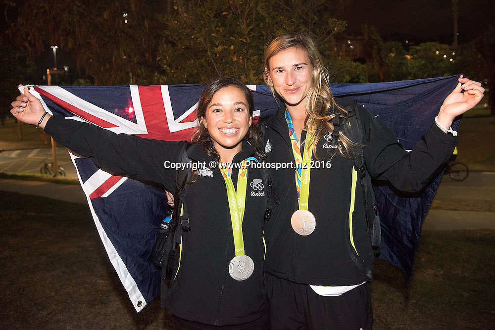 New Zealand's Alex Maloney and Molly Meech celebrate winning Silver for the 49er class sailing race the 2016 Rio Olympics on Thursday the 18th of August 2016. © Copyright Photo by Marty Melville / www.Photosport.nz