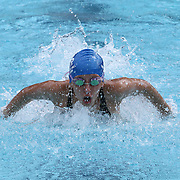 Swimmer Meagan Pfeifer (13) competes in the 100 meter individual medley during the Summer Swim league championships finials Saturday, July. 17, 2015 at Western YMCA in Wilmington, DEL