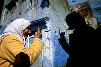 Japanese tourist Anna Naganuma interacts with a woman from the town of Chaouen.