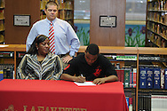 Lafayette High's Jamel Dennis signs a National Letter of Intent to play football at Itawamba Community College, in Oxford, Miss. on Wednesday, February 1, 2012.