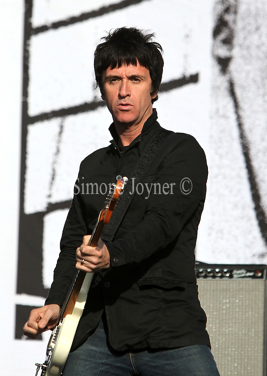 Johnny Marr of The Cribs performs live on the Main stage during day Two of Reading Festival on August 28, 2010 in Reading, England.  (Photo by Simone Joyner)