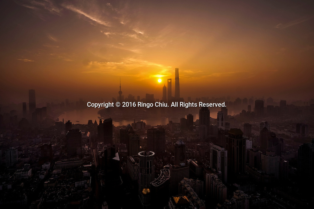 View of Shanghai with the Pudong skyline as seen at sunrise from the Meridien Hotel in Shanghai, China, Shanghai is the most populous city in China and the most populous city proper in the world. It is one of the four direct-controlled municipalities of China, with a population of more than 24 million as of 2014. It is a global financial centre, and a transport hub with the world's busiest container port. Located in the Yangtze River Delta in East China, Shanghai sits on the south edge of the mouth of the Yangtze in the middle portion of the Chinese coast. The municipality borders the provinces of Jiangsu and Zhejiang to the north, south and west, and is bounded to the east by the East China Sea. A major administrative, shipping, and trading town, Shanghai grew in importance in the 19th century due to trade and recognition of its favourable port location and economic potential. The city was one of five forced open to foreign trade following the British victory over China in the First Opium War while the subsequent 1842 Treaty of Nanking and 1844 Treaty of Whampoa allowed the establishment of the Shanghai International Settlement and the French Concession. The city then flourished as a center of commerce between China and other parts of the world (predominantly Western countries), and became the primary financial hub of the Asia-Pacific region in the 1930s. However, with the Communist Party takeover of the mainland in 1949, trade was limited to socialist countries, and the city's global influence declined. In the 1990s, the economic reforms introduced by Deng Xiaoping resulted in an intense re-development of the city, aiding the return of finance and foreign investment to the city. Shanghai has been described as the &quot;showpiece&quot; of the booming economy of mainland China; renowned for its Lujiazui skyline, museums and historic buildings, such as those along The Bund, the City God Temple and the Yu Garden.(Photo by Ringo Chiu/PHOTOFORMULA.com)<br /> <br /> Usag