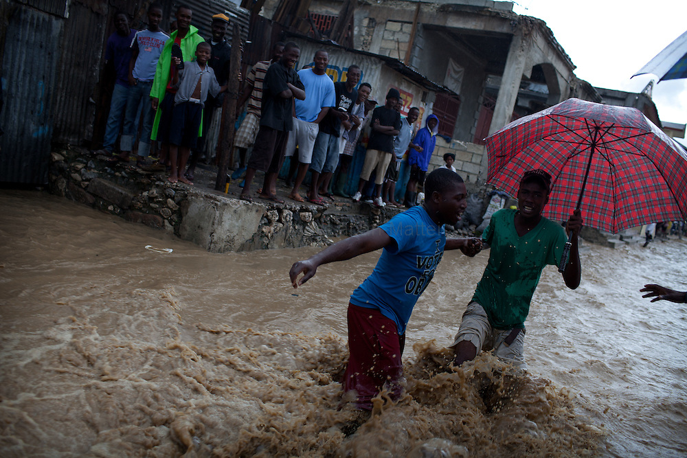 After hurricane Tomas went through Haiti, the city of Leogane has been totally flooded by the heavy rain and the overflow of the river Roullorne.///Haitians try to go out of the the muddy water, in a street of Leogane during hurricane Tomas.