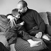 Aidan Sumner, 4, cuddles with his dad, Joseph, January 30, 2008.  Aidan, who has both autism and lead poisoning, and his family being evicted from their Roslindale home where he contracted the lead poisoning.