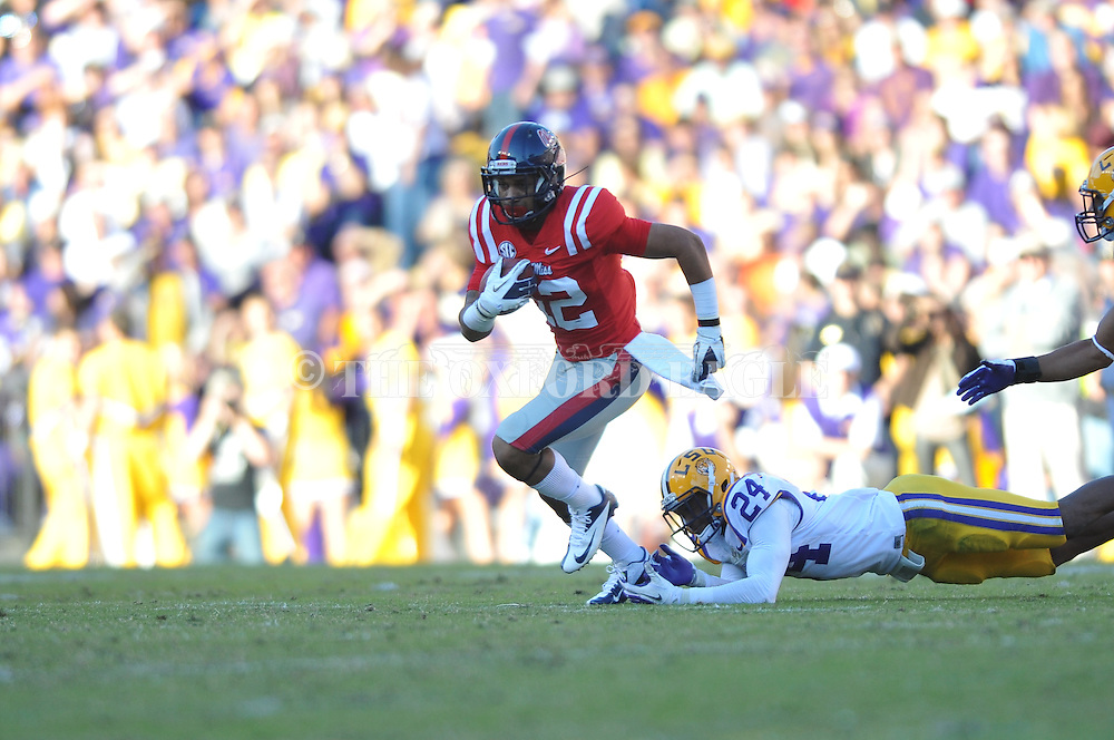 Ole Miss wide receiver Donte Moncrief (12) escapes LSU cornerback Tharold Simon (24) to score on a 46 yard play at Tiger Stadium in Baton Rouge, La. on Saturday, November 17, 2012.....