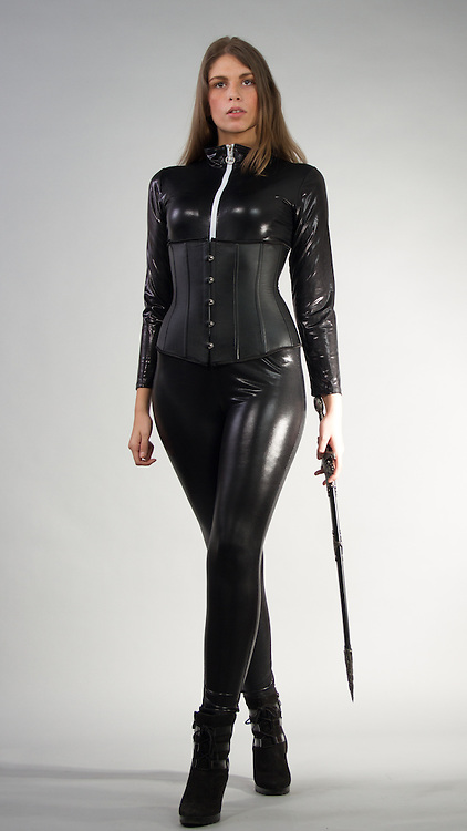 Female model posing in a catsuit and a corset with a sword.