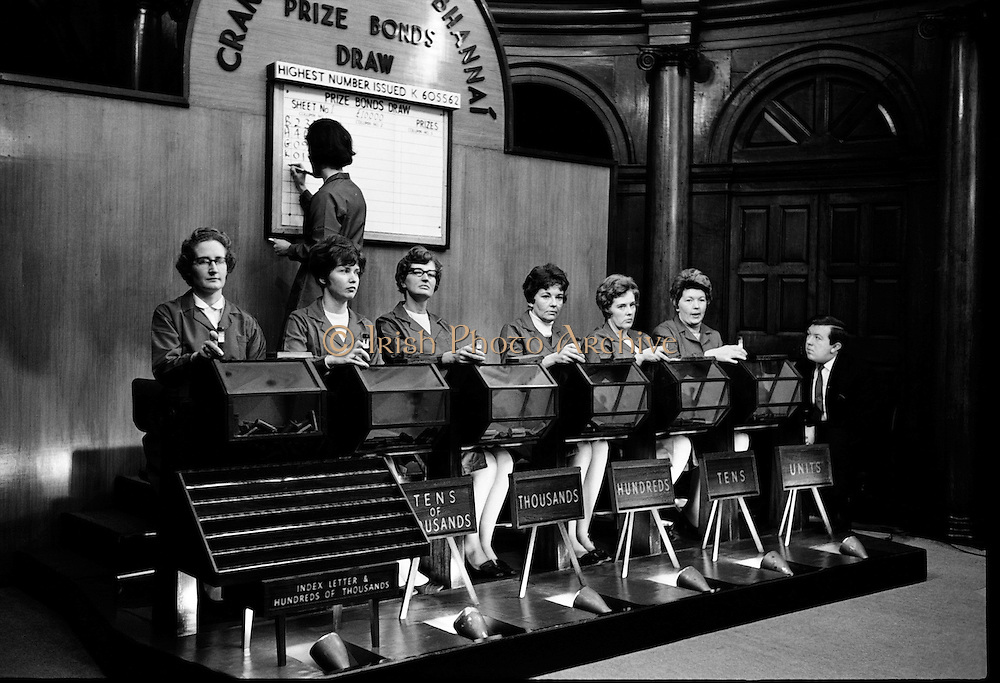 A Prize Bond Draw was held at Bank of Ireland, College Green, Dublin.  There will be 2,500 prizes drawn.  This is the second of the Special Monthly Draws which were announced last year.  Mr J. B. Jennings, Superintendent of Prize Bonds, officially opened the draw..03.03.1969