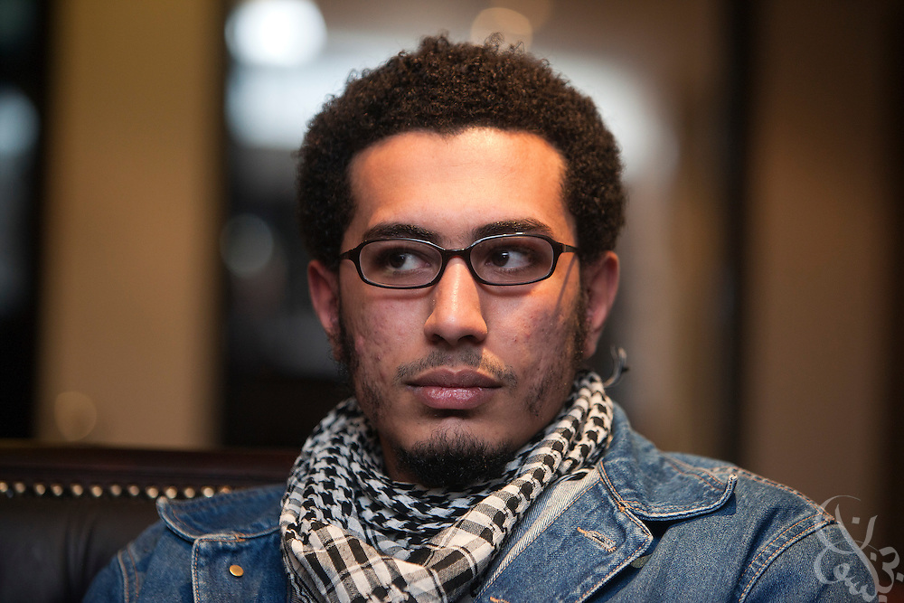 Egyptian blogger and activist Michael Adel speaks with a Der Spiegel correspondent in a cafe in central Cairo January 17, 2012.