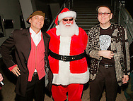 Robin Zander and Rick Nielsen of Cheap Trick with Santa Claus at Alice Cooper's Christmas Pudding show for his Solid Rock Foundation Charity at Dodge Theatre in Phoenix, Arizona, December 18th 2004. Photo by Chris Walter/Photofeatures.