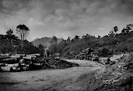 A logging camp in northern Peninsular Malaysia on the edge of the homeland of the Batek Negrito people, which is the first step on the conversion from old growth rainforest to oil palm plantations.  Manik Urai, Kelantan, Malaysia.