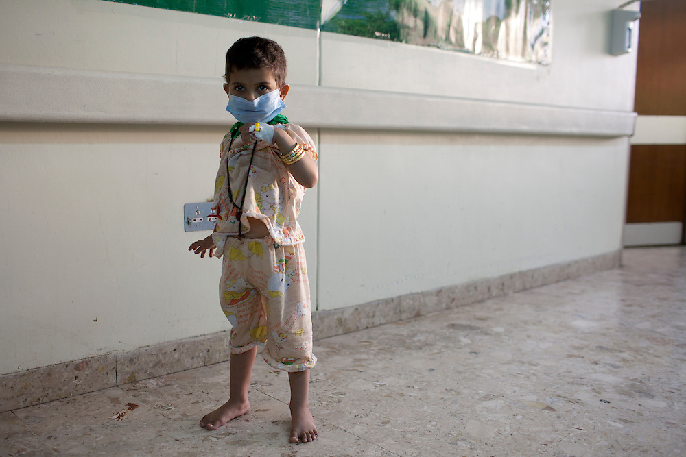 A young cancer patient stands in the hallway at a hospital in Medical City on Sunday, October 24, 2010 in Baghdad, Iraq.