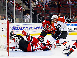 Oct 24, 2008; Newark, NJ, USA; Philadelphia Flyers right wing Mike Knuble (22) scores on New Jersey Devils goalie Martin Brodeur (30) during the first period at the Prudential Center.