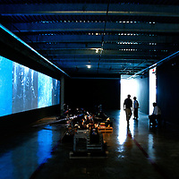 "MIAMI, FL -- January 19, 2008 -- Visitors watch ""Ocean's Symphony,"" an installation by Hernan Bas, at The Rubell Family Collection in the Wynwood Art District in Miami, Fla., on Saturday, January 19, 2008.  The collection is expansive in a 45,000 sq. ft. former D.E.A. confiscated-goods warehouse with contemporary works collected by the Rubell family since the 1960's."