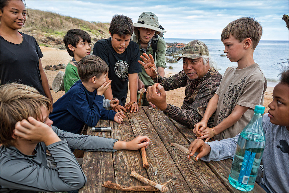 Brother Nolan asks tracking questions at Kapukahehu also known as Dixie Maru beach, West Molokai.