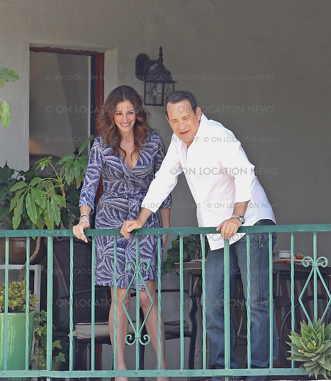 June 4th 2010 Pasadena, CA. Non Exclusive. Tom Hanks and Julia Roberts looking cute and adorable together as they film a scene for Larry Crowne in which Hanks serves a breakfast of french toast to Roberts on his apartment terrace. Photo by D Mayer/Eric Ford/ On Location News 818-613-3955 info@onlocationnews.com