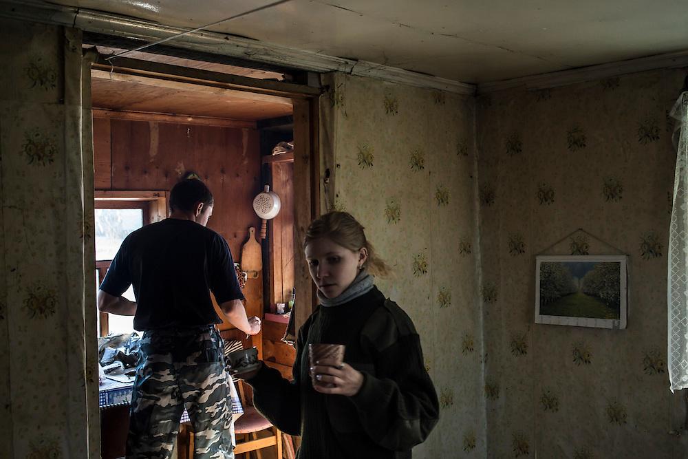 Vadim Kovalenko and Marina Telezhnikova serve tea at Vadim's dacha on Sunday, October 27, 2013 in Baikalsk, Russia.