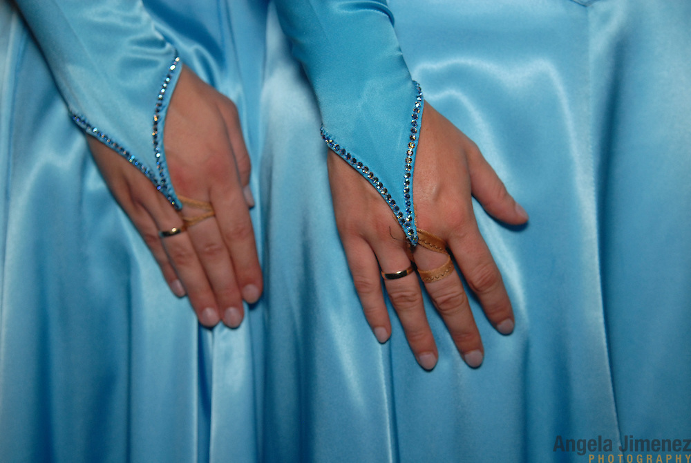 Christel, left, and Miriam Andeweg, a married lesbian couple and dance partners from Holland, pose for a photo in their standard division costumes while competing in the same-sex ballroom dancing competition during the 2007 Eurogames at the Waagnatie hangar in Antwerp, Belgium on July 14, 2007. ..On their hands are their wedding rings. ..Over 3,000 LGBT athletes competed in 11 sports, including same-sex dance, during the 11th annual European gay sporting event. Same-sex ballroom is a growing sports that has been happening in Europe for over two decades.
