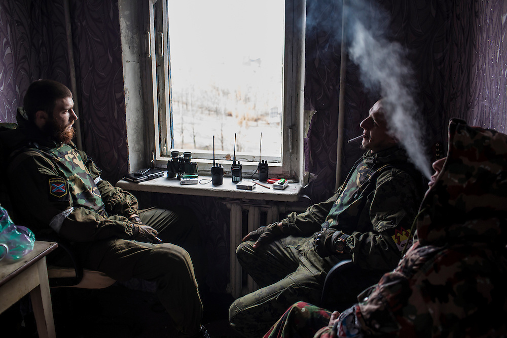 Pro-Russian rebel fighters sit in an apartment building where they can observe and coordinate fighting to gain control of the Donetsk airport on Friday, October 17, 2014 in Donetsk, Ukraine. Photo by Brendan Hoffman, Freelance