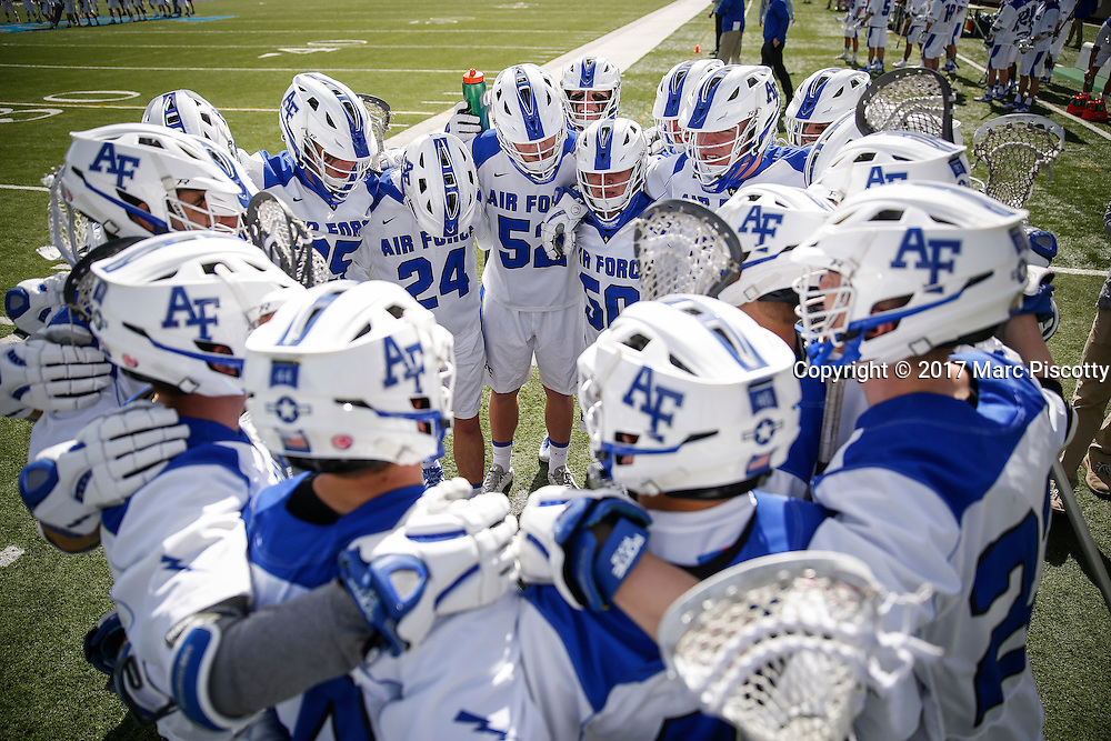 SHOT 2/18/17 12:55:15 PM - Air Force lacrosse players huddle up before playing Marist College at Falcon Stadium at the Air Force Academy in Colorado Springs, Co. Marist won the game 10-4.<br /> (Photo by Marc Piscotty / &copy; 2017)